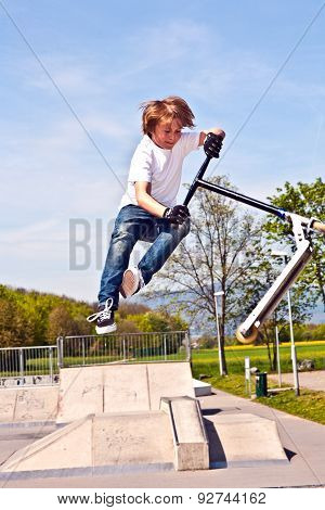 Boy Jumping With His Scooter In The Sky