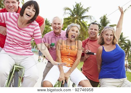 Group Of Senior Friends Having Fun On Bicycle Ride