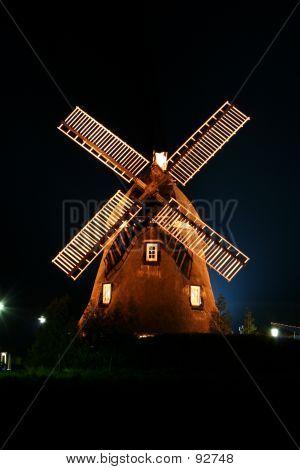 Windmill Illuminated At Night.