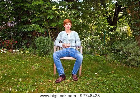 Boy Sitting In His Garden