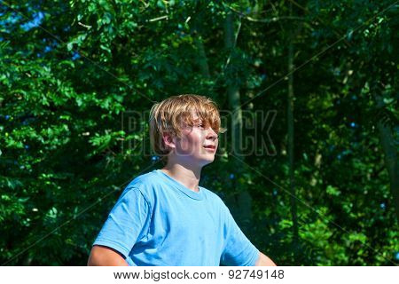 Cute Boy Sweating After Outdoor Sports In Nature