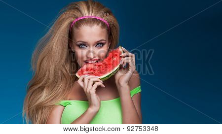 Portrait Of Blonde Woman Eating Watermelon.