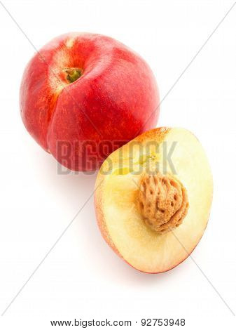 White Nectarine Whole And Sliced Over White
