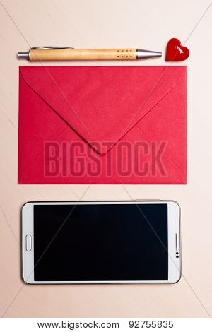 Red Envelope Heart And Phone On Table