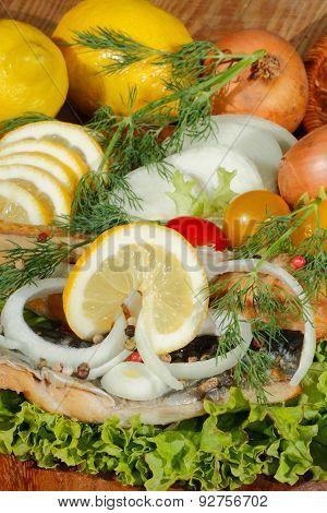 Smoked Mackerel Fillet With Salad, Lemon, Onions, Tomato
