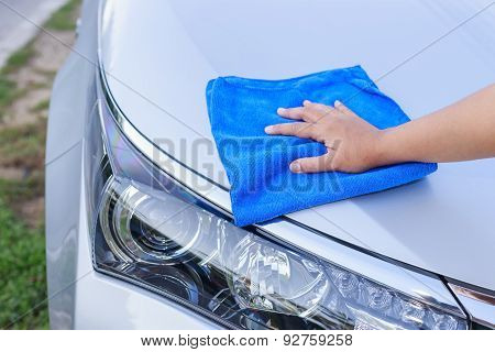 Woman Hand With Blue Microfiber Cloth Cleaning The Car