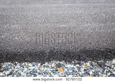 Close Up Rock And New Asphalt Road Texture