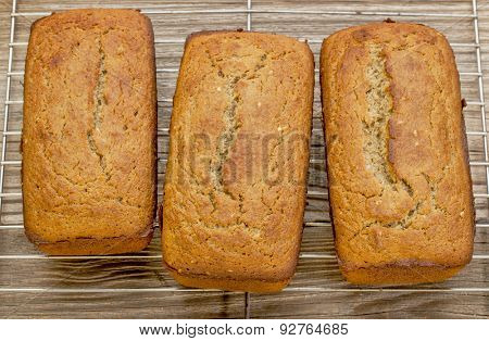 loafs of freshly baked gluten free bread prepared with coconut and almond flour, flaxseed meal with sesame seeds