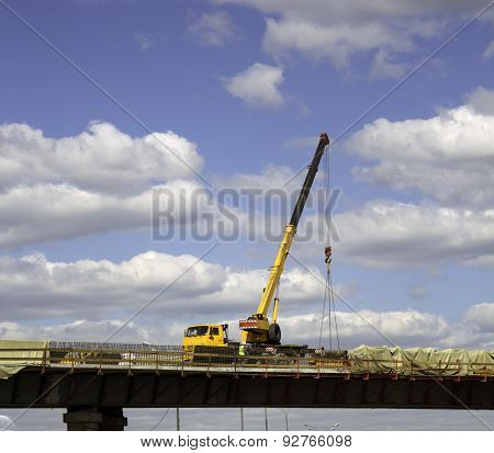 Truck Crane Work On Building Overpass