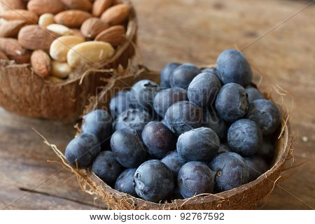 Blueberries And Almonds In The Shell Of A Coconut
