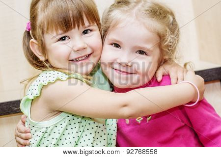 Two Happy Little Girls Hugging