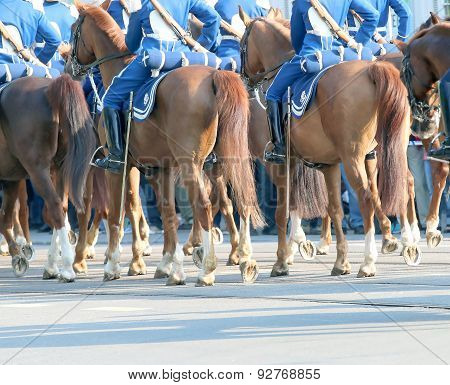 The Royal Guards In Blue Dresses On The Horse Back