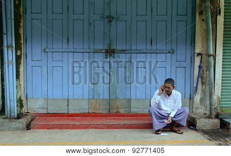 Burmese Man Talking On Mobile Phone