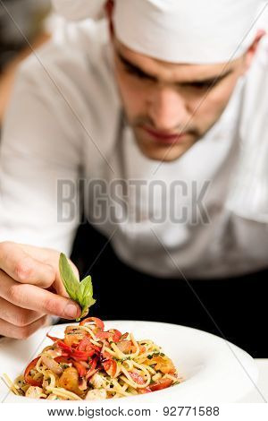 Chef Garnishing Pasta