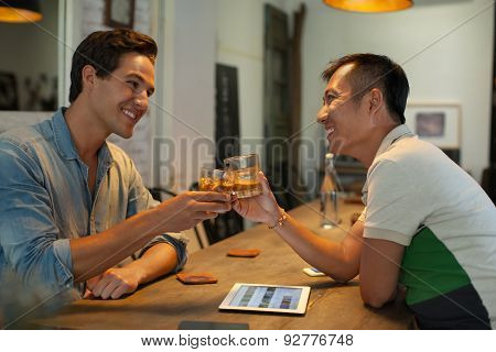 Two Men Cheers Toast Drink Ice Coffee, Asian Mix Race Friends