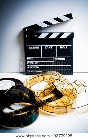 Movie Clapper With 35 Mm Film On White