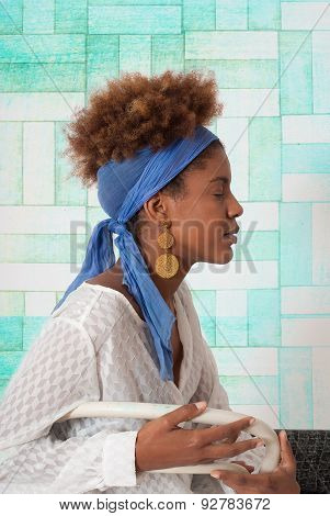 Young Afro American Woman Profile With Closed Eyes - Studio Shot - Turquoise Design Background