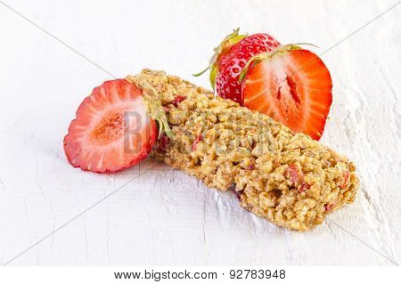 Muesli Bars with Fresh Strawberry on White Wood