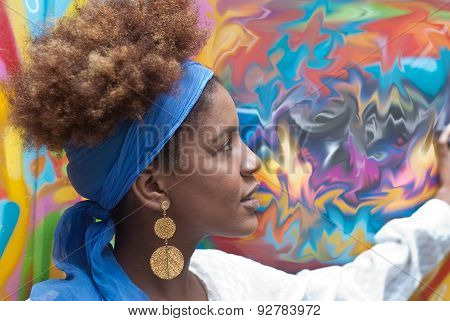 Head Shot Of Young Afro American Curly Woman Profile In Front Of Colorful Abstract Background