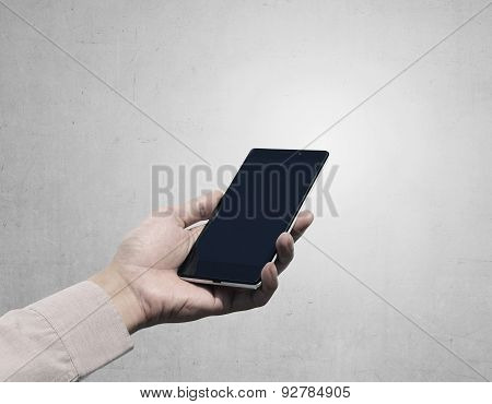 Hand Holding Cellphone With Blank Screen On Grunge Background