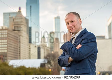 Successful businessman among office buildings.
