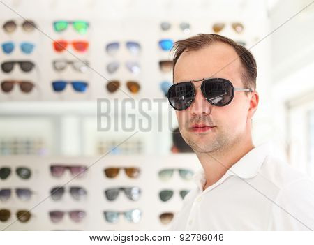 Man Trying On New Sunglasses
