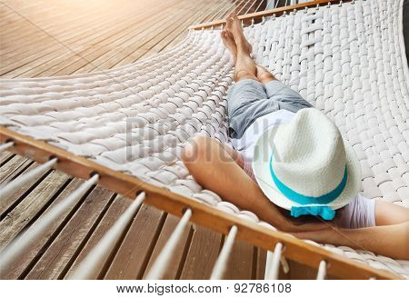 Man In Hat In A Hammock On A Summer Day