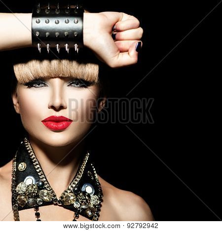 Beauty Punk Fashion Model Girl. Rocker Style Model Portrait. Fringe Hairstyle. Rocker or Punk Woman Makeup and Accessories. Isolated on black background