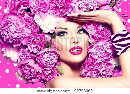 Beauty High Fashion Model Girl with pink Peony hair style. Vivid Make up. Beautiful Model woman with Blooming flowers on her head. Nature Hairstyle. Summer. Holiday Creative Makeup and manicure