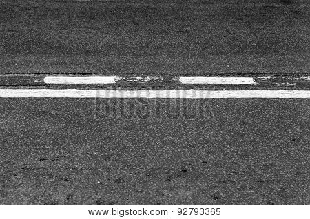 Asphalt Road With Dividing Line And Tire Tracks