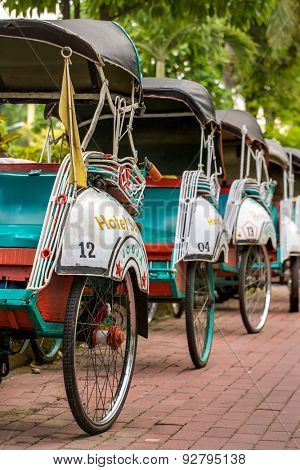 Yogyakarta, Indonesia - April 2, 2015: Trishaws on the street of Yogyakarta, Indonesia