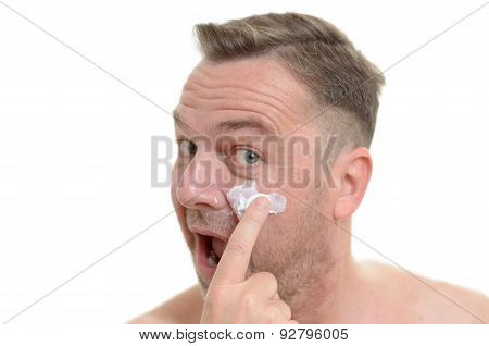 Man Applying Moisturizer To His Skin