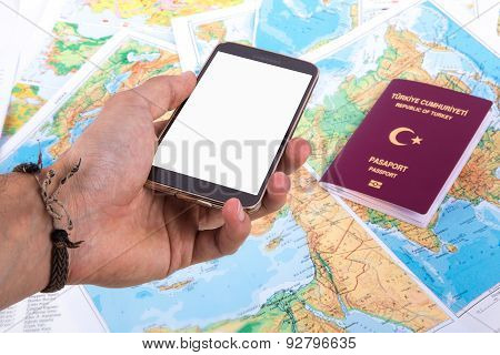 Smartphone And Passport On World Map