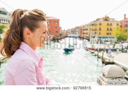 Smiling Woman In Profile In Venice Standing Above Canal