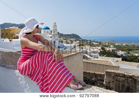 Woman In A Long Dress, Island Santorini, Greece.