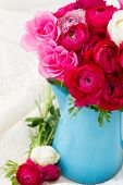 picture of bunch roses  - bunch of fresh pink  ranunculus and rose flowers  in blue pot close up - JPG