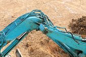 image of excavator  - arm of excavator tractor working in construction site - JPG