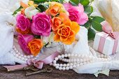 pic of mother-of-pearl  - fresh pink and orange roses with lace and pearls - JPG