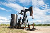 foto of oil well  - pumpjack pumping crude oil from oil well - JPG
