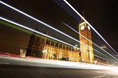 stock photo of london night  - Big Ben and London at night with the lights of the cars passing by the most prominent symbols of both London and England - JPG