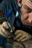 pic of freaky  - Closeup portrait of freaky tattoo artist in his studio - JPG
