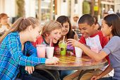 image of pre-adolescent child  - Group Of Children In Caf - JPG