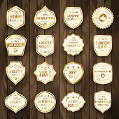 Set of Retro Gold Premium Quality Badges and Labels on Wooden Background. poster