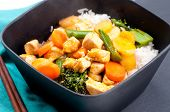 stock photo of curry chicken  - Thai coconut and mango curry with diced chicken and sliced carrots over coconut rice - JPG