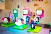 pic of arcade  - Arcade Game Machine Shop Blur Background With Bokeh Image  - JPG