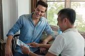 pic of mans-best-friend  - Two Men Using Tablet, Asian Mix Race Friends Guys Sitting at Cafe Natural Light ** Note: Visible grain at 100%, best at smaller sizes - JPG