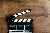 stock photo of clapper board  - Movie clapper board on old wooden background - JPG
