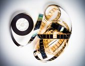 picture of mm  - Unrolled 35 mm movie film on white background vintage color effect - JPG