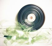 stock photo of mm  - Movie 35 mm film reel on white background vintage color effect - JPG