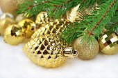 pic of bump  - Gold bump and Christmas decorations on a spruce branch - JPG